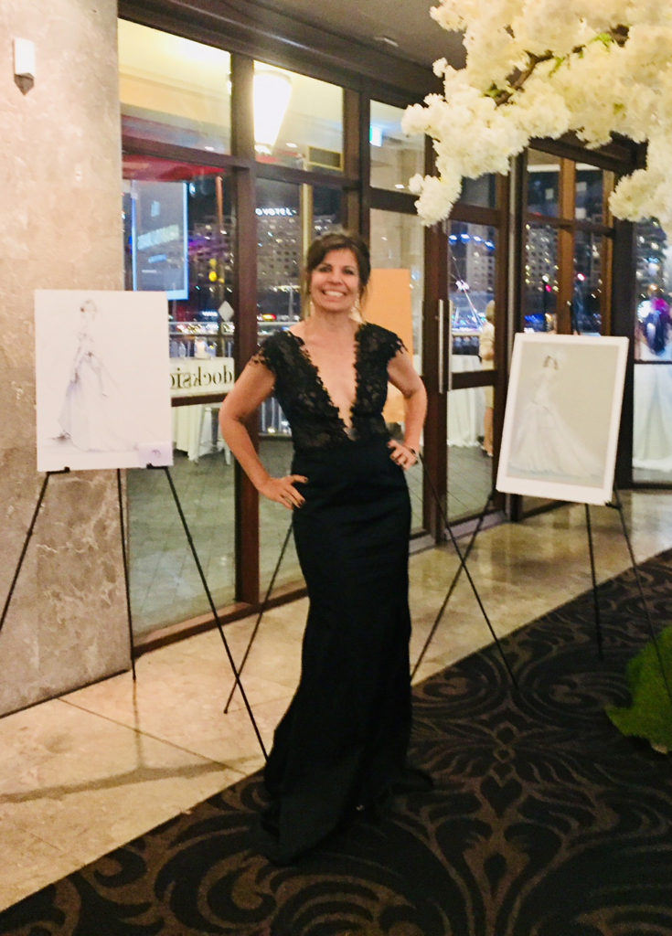 Wearing an original gown designed by Brides by Francesca of Rockdale, I am posing with my works on display at the Australian Bridal Industry Awards (ABIA) in November 2017 at dockside, Darling Harbour.